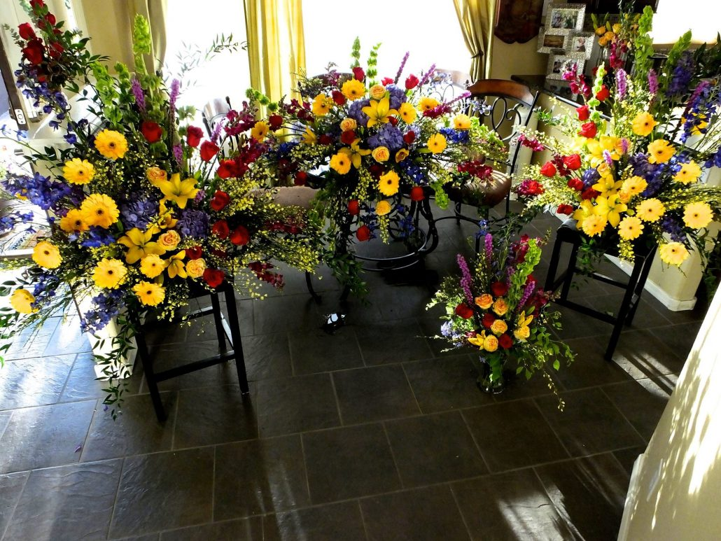 Colorful Casket spay, pedestal arrangements