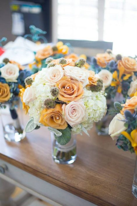 Antique gold, cream, and navy wedding bouquets